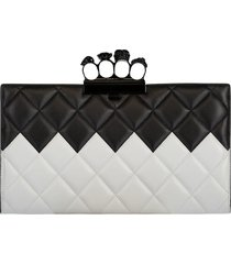 four ring black and white flat clutch