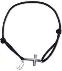 he rocks black cord bracelet featuring stainless steel cross