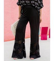 pantaloni svasati in pizzo con patchwork per le donne