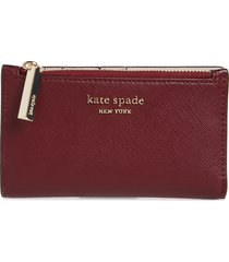 kate spade new york small spencer slim leather bifold wallet in grenache at nordstrom