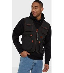 puma tfs industrial woven vest jackor black