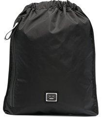 acne studios face-plaque drawstring backpack - black