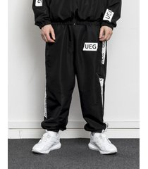 spodnie dresowe black tracksuit bottom with tapes