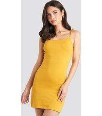 na-kd tie strap jersey mini dress - yellow