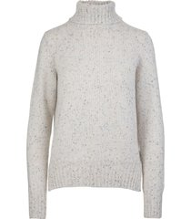 woman white derby iside sweater