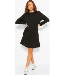 gesmokte jurk met knopen, lange mouwen en laagjes, black