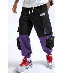 bolsillos con cremallera de empalme en bloque de color estilo hip hop para hombre carga pantalones