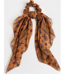 women's nela floral border print pony scarf in tan by francesca's - size: one size