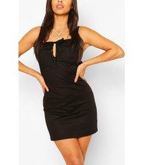 petite mini jurk met knopen, zwart