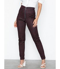 nly trend check zip pants byxor