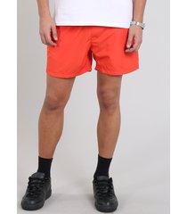 short masculino com bolso laranja