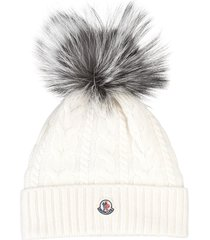 white woman hat with fur pompon