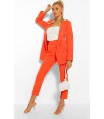 broek met wijd uitlopende pijpen en split, oranje