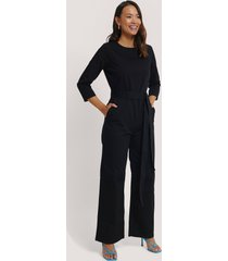 na-kd trend belted waist detail jumpsuit - black
