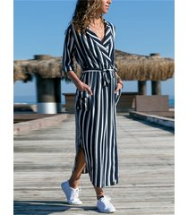 vestido de manga larga con diseño de lazo y cinturón a rayas