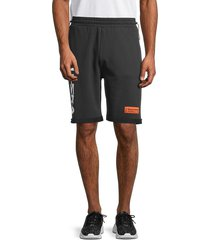 heron preston men's spray logo side drawstring shorts - black - size m
