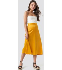 na-kd party bias cut satin midi skirt - yellow