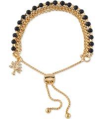unwritten blue stone crystal tree bolo bracelet in gold-tone plated brass