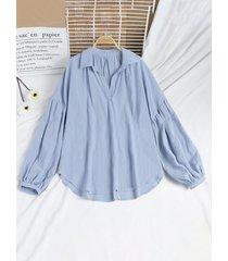 camicetta ampia a maniche lunghe con risvolto in tinta unita per donna
