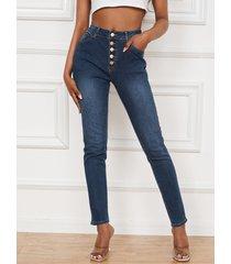 denim de cintura alta con botonadura simple y bolsillo lateral jeans