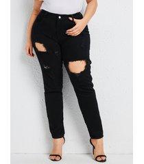 pantalones rasgados de mezclilla con diseño de botones de talla grande
