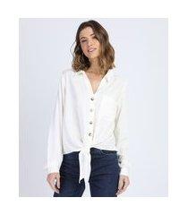 camisa feminina cropped com bolso e nó manga longa off white