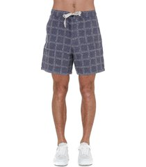 j.w. anderson allover logo shorts