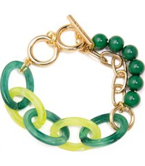 toggle bracelet made of marbled resin links, resin beads, and a shiny, gold-tone chain.