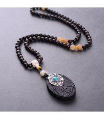 collana pendente vintage padauk con perle nere e geometriche a forma di ciondolo