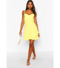 tall jurk met stippen en ruches, geel