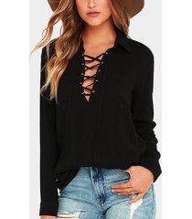 blusa negra de manga larga diseño con cordones