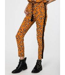 pantalón naranja sans doute fyris