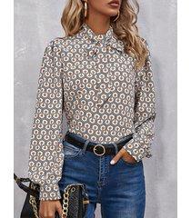 camicetta con fiocco a manica lunga con risvolto e stampa geometrica da donna