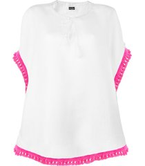 white linen poncho with fucsia tassels