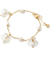 kate spade new york gold-tone freshwater pearl (5x7mm) flower charm bracelet