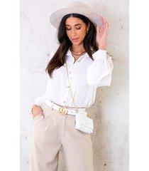 blouse met gouden knopen wit