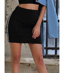 minifalda patchwork letra negra