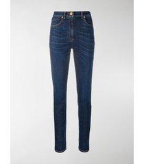 versace medusa print skinny jeans