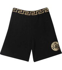 young versace black shorts with golden print