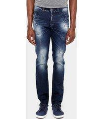 calça jeans skinny zune desfiada respingos masculina