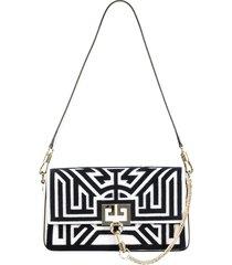 tufted labyrinth charm shoulder bag