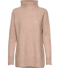 this knit with t-neck is made in a soft wool blend. it has turtleneck coltrui beige second female