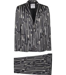 moschino all-over zip printed suit