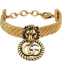 gucci lion head bracelet - gold