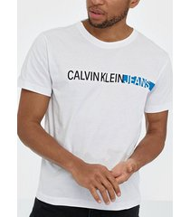 calvin klein jeans stripe institutional logo tee t-shirts & linnen white