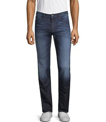slim-fit whiskered jeans