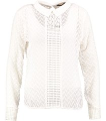 supertrash off white polyester blouse met losse ondertop