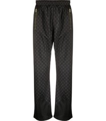 sss world corp all-over print track trousers - black