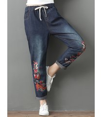 jeans a ricamo vintage con tasche