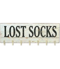 """lost socks"" wall decor with clothespins"